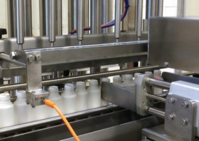 6 head servo-controlled filling machine installed at cosmetics company